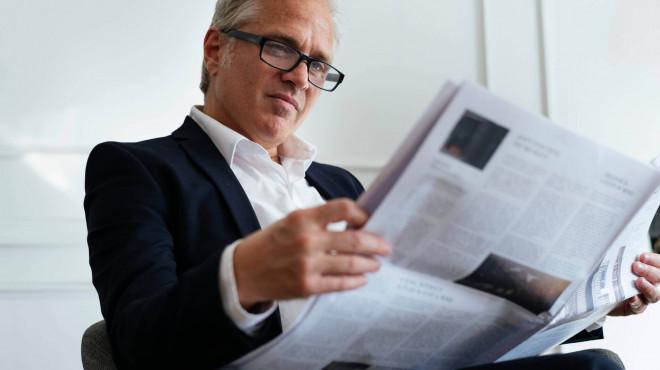 men reading news paper