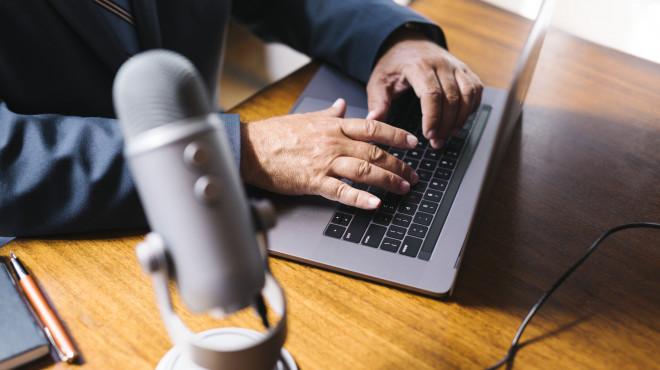 Male radio host broadcasting live in a studio